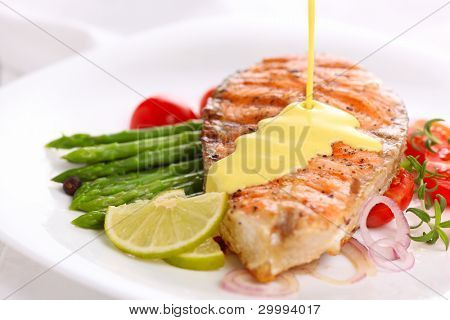 Grilled salmon with lime, asparagus and saffron sauce with rosemary poster