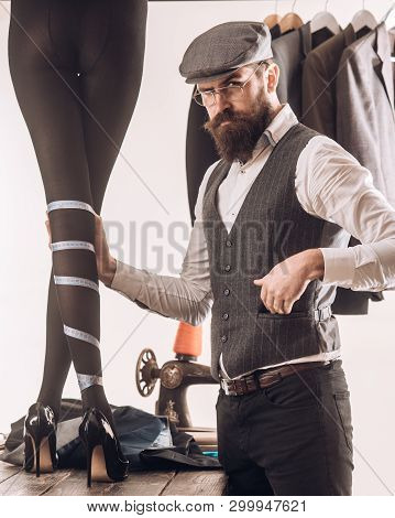 We Love Designer. Womens Tailor Making Designer Collection Of Fashion Dresses. Bearded Man Dressmaki