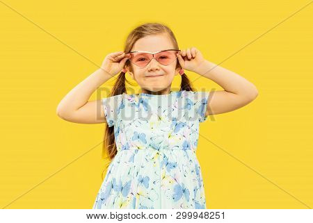 Beautiful Emotional Little Girl Isolated On Yellow Background. Half-lenght Portrait Of Happy Child S