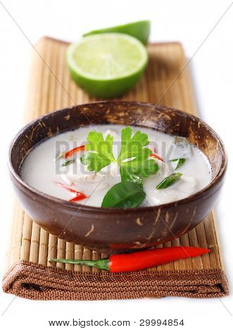 Thai chicken and coconut milk soup on white isolated background