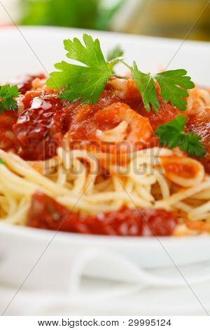 Pasta with tomato sauce, sun dried tomato and shrimp