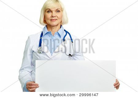 Smiling female doctor holding an empty banner and looking at camera