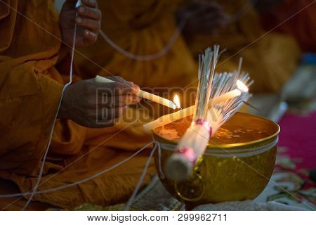 Buddhist Monk Praying Above Holy Water Bowl In Wedding Ceremony. Buddhist Temple Wedding Ceremony Ce