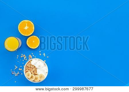 Bright Breakfast With Granola And Orange Juice On Blue Background Top View Mockup