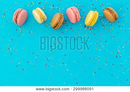 Brignt Macarons For Sweet Break On Blue Background Top View Mock Up