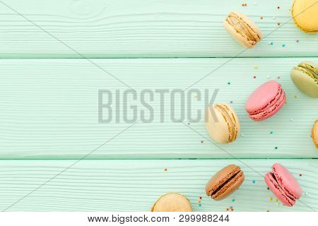 Brignt Macarons For Sweet Break On Mint Green Background Top View Mock Up