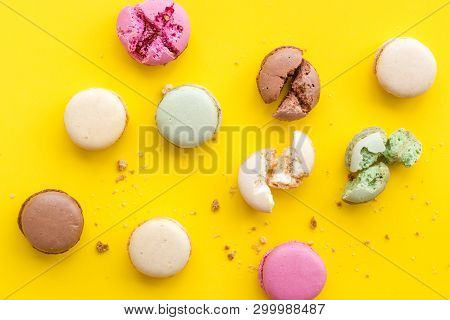 Macarons Design On Yellow Background Top View Pattern