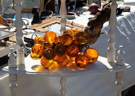 Stand With Vintage Glass Grape At Flea Market.