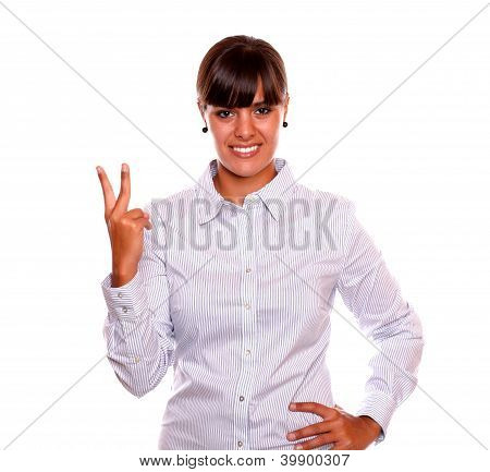 Adult Woman Holding Up Two Fingers In Victory Sign