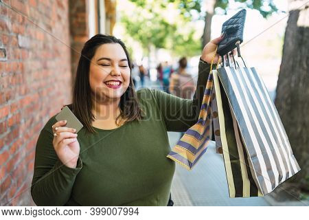 Portrait Of Young Plus Size Woman Holding