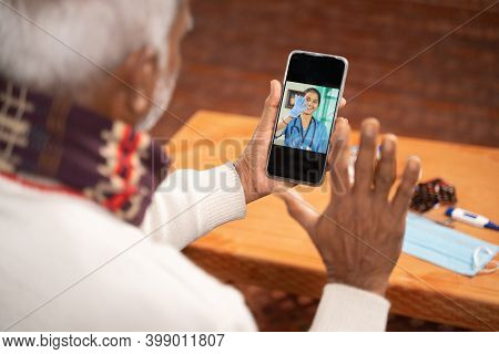 Shoulder Shot Of Old Man On Video With To Doctor On Mobile Phone - Concept Of Nurse Online Chat, Tel