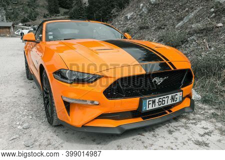 Pralognan - France - August 25, 2020 : Ford Mustang Gt Orange Fury