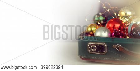 Christmas Decorations In An Ajar Retro Suitcase