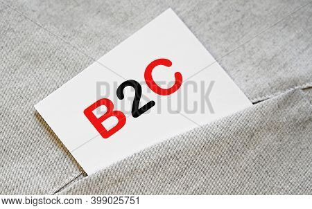 Word B2c Written On White Sticker In The Shirt Pocket