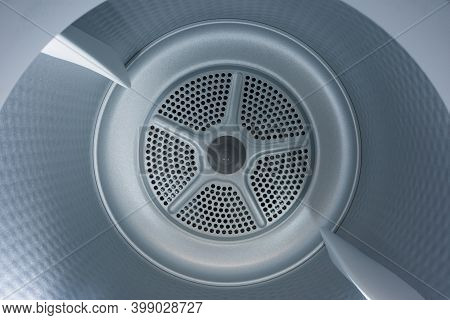 Interior View Of The Tumble Dryer. Conceptual Image Of Housework And Laundry.