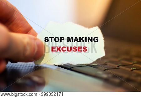 Motivational Text Stop Making Excuses On Paper On Notebook Background.
