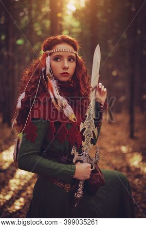 Fantasy world. A beautiful warrior woman with a sword in a deep forest. Ancient legends.
