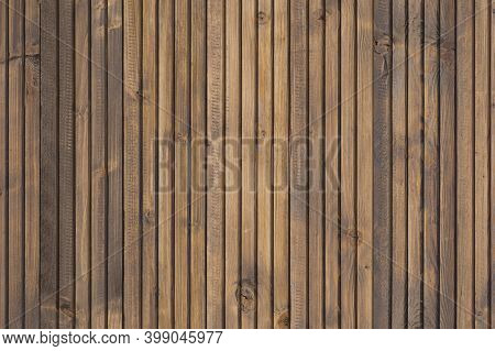 A Fine Wood Background In Dark Brown Tone. In Vertical Position. Texture And Detail Of Wood Fence. A