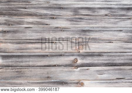A Old Wood Background With Totally Worn Out Paint, Wood Texture With Long Aligned Boards. Wooden Boa