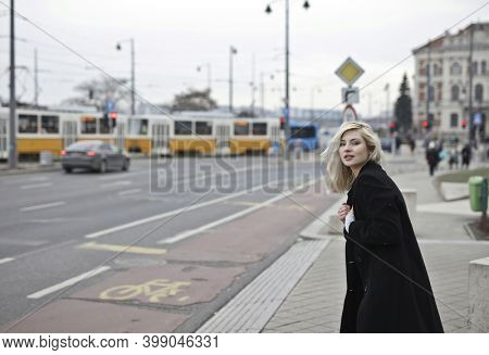 beautiful blond woman in the street
