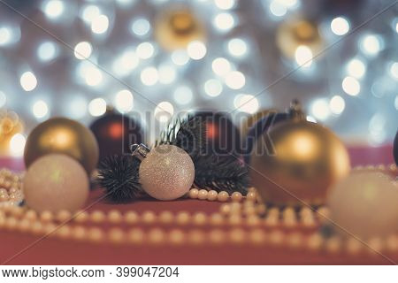 White Christmas Ball And Branch Of Christmas Tree With Blur Christmas Balls And Christmas Beads On B