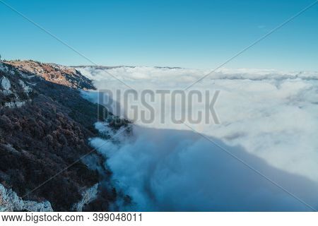 Broken Ghost High In The Mountains Above The Fog Waves, Surrounded By Gloria. Silhouettes On A Stron