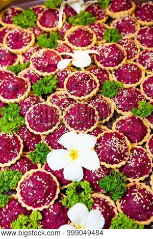 Vertical Photo, Traditional Russian Beet Salad In Waffle Baskets For New Year Decorated With Sesame