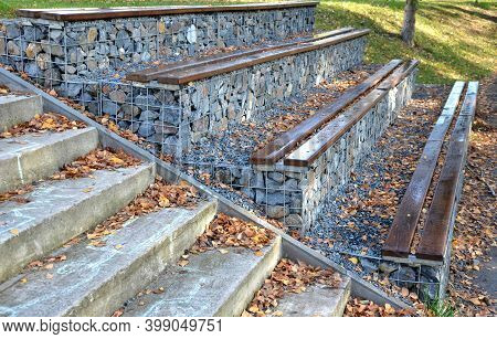 Grandstand In The Park By A Concrete Staircase Made Of Gabion Baskets With Gray Stones Arranged Insi