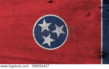 Flag Of Tennessee On Wooden Plate Background. Grunge Tennessee Flag Texture, A Blue Circle With Thre