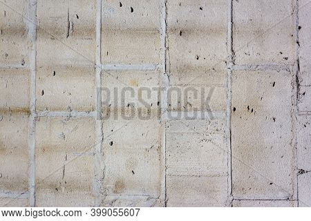 Old Wall Made Of Grey Brick, Painted White In Loft Style. Background Of Grey Building Bricks. Wall I