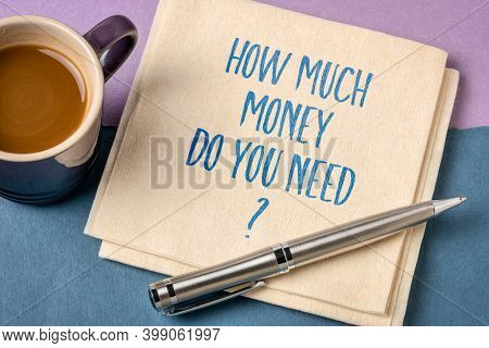 How much money do you need? Handwriting on a napkin with a cup of coffee. FInance palnning and starting business concept.