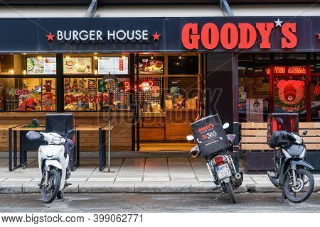 Thessaloniki, Greece - December10 2020: Goodys Burger House With Delivery Motorbikes Outside. Evenin