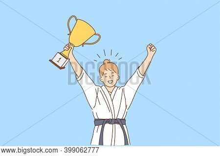 Girl Karate Fighter And Winner Concept. Smiling Happy Girl In White Kimono With Belt Karate Fighter