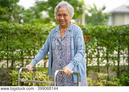 Asian Senior Or Elderly Old Lady Woman Use Walker With Strong Health While Walking At Park In Happy