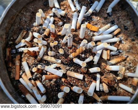 High Angle View Of Waste Cigarette Butts With Selective Focus