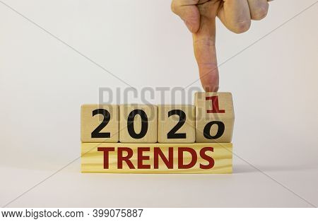 Business Concept Of 2021 Trends. Male Hand Flips Wooden Cube And Changes The Inscription 'trends 202