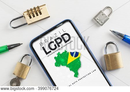 Lgpd (brazilian Data Protection Law) Concept: Smartphone Sorrounded By Padlocks With An Imaginary Pa