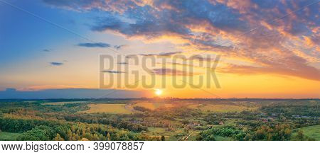 Autumn Rural Landscape - A Village With Small Houses In The Middle Of A Valley In The Haze At Sunset