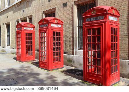 London Telephone Box Row. London Landmarks - Red Phone Booth.