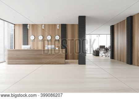 Interior Of Stylish Office With Gray And Wooden Walls, Concrete Floor, Reception Desk And Clocks. Op