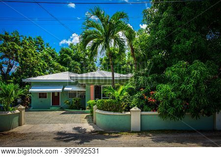Grand Cayman, Cayman Islands, July 2020, View Of A Popular Style House With Front Garden And Drivewa