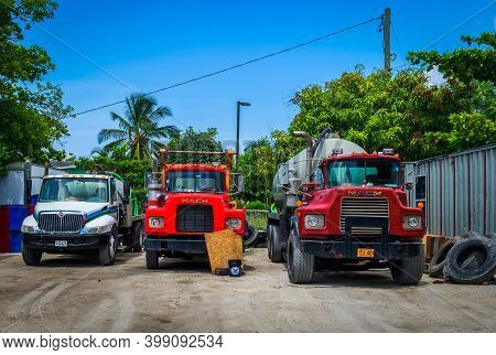 Grand Cayman, Cayman Islands, July 2020, View Of Three Trucks Parked