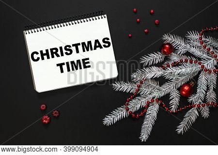 Flat Lay Composition With Notebook With The Inscription Christmas Time, Silver Spruce Branch, Christ