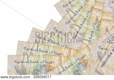 25 Egyptian Piastres Bills Lies In Different Order Isolated On White. Local Banking Or Money Making