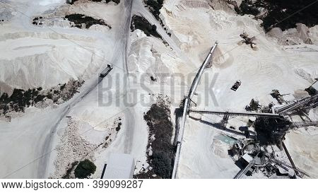 Large Quarry Withe Stone Sorting Conveyor Belts And An Open Pit Mine.