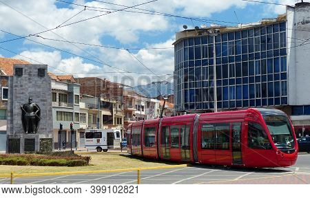 Cuenca, Ecuador - August 10, 2020: Red City Tramway (tram) On The Busy Road In Center Of City Cuenca