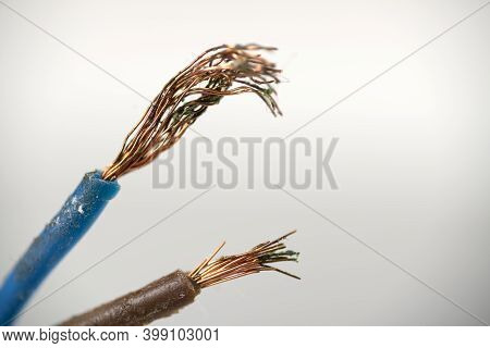 White Wire Without Insulation For Power Supply Close-up. Broken Electrical Wire