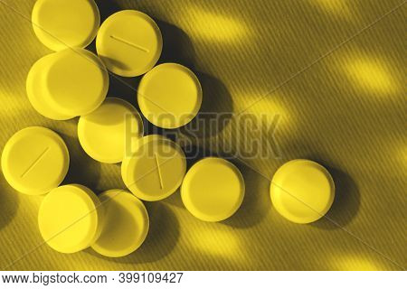 Pills Over Yellow Background. Pills, Drugs, Health And Medicine Concept. Abstract Colorful Backgroun