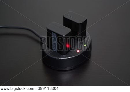 Close Up Of Rechargeable Lithium-ion Battery Charger On Black Table