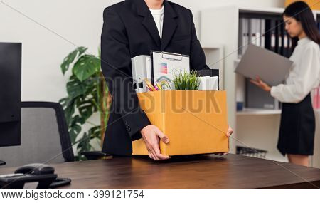 Businessman Packaging And Holding Brown Cardboard Box With Documents And Personal Office Supplies Be